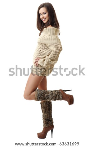 smiling brunette woman wearing braces and posing on white background