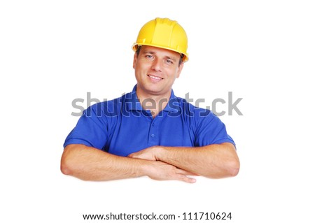Smiling builder holding the blank board