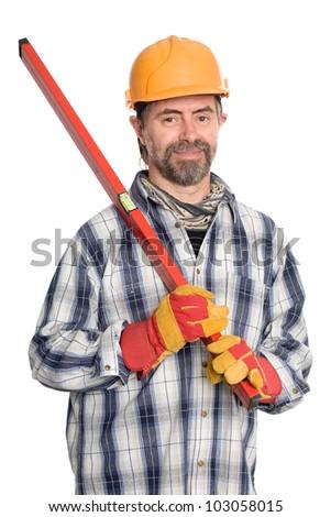 Smiling builder holds a builder's level.