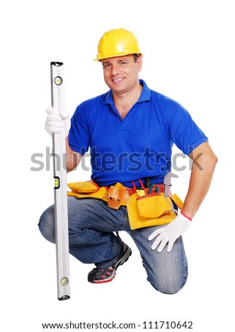 Smiling builder standing on his knee