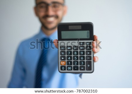 Smiling Business Man Showing Zero on Calculator Stock photo ©