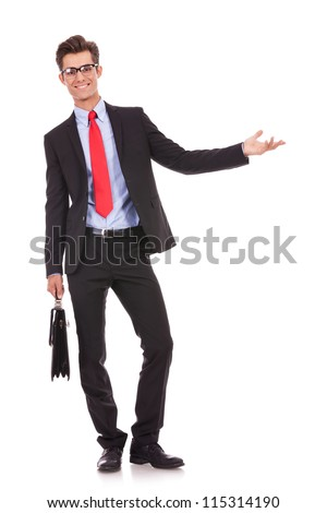 Smiling business man with a briefcase welcoming you on white background