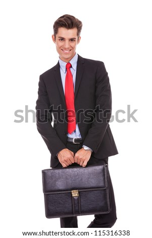 smiling business man with a suitcase, looking at the camera