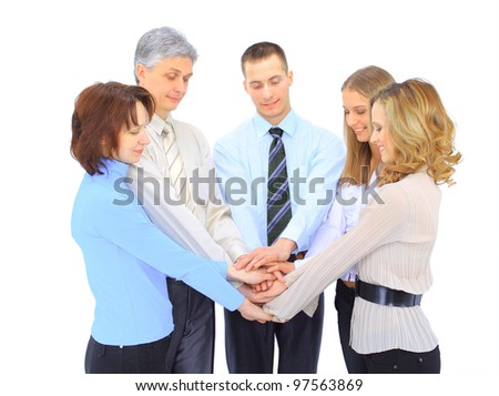 Smiling business people holding hands together in a circle against white background
