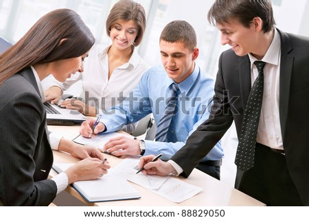Smiling business people  in board room - Staff meeting