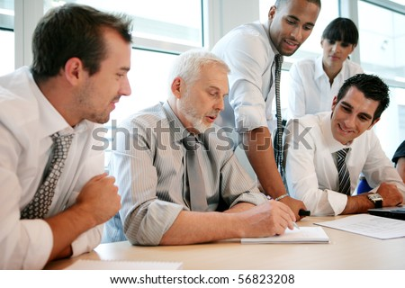 Smiling business people sitting at a desk
