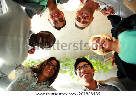 Smiling business people with their heads together representing concept of ftiendship and teamwork