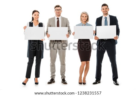 smiling business team holding blank cards isolated on white