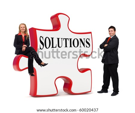 Smiling business team with a solutions puzzle board - Isolated