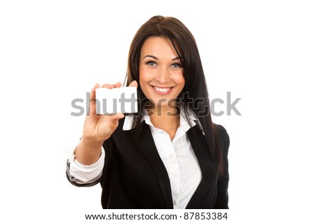 Smiling business woman handing a blank business card over white background
