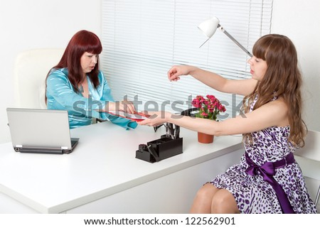 smiling business woman interviewing a young girl