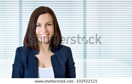 Smiling business woman. Isolated over jalousie