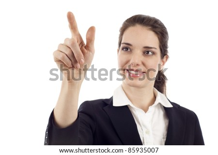 Smiling business woman pointing at the screen isolated over white background