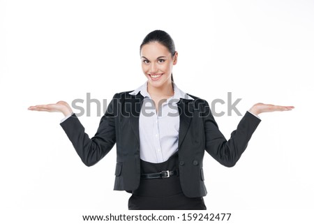 Smiling business woman showing open copy space with both hands. Standing isolated on white