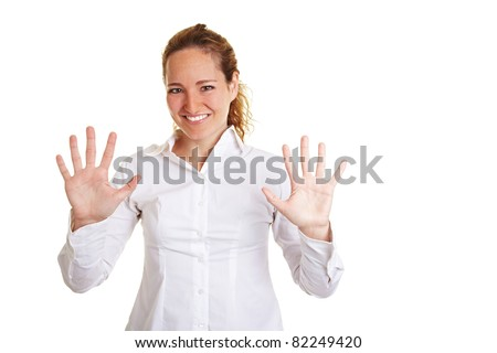 Smiling business woman showing ten fingers on both hands