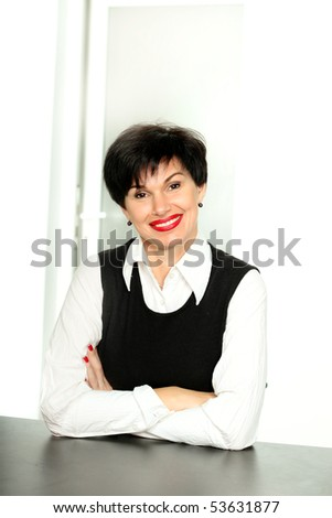 Smiling business woman sitting at the table