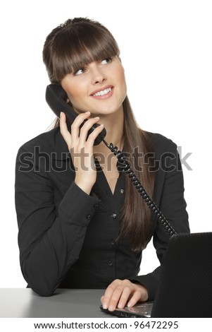 Smiling business woman talking on the phone at her work desk looking upwards, isolated on white background