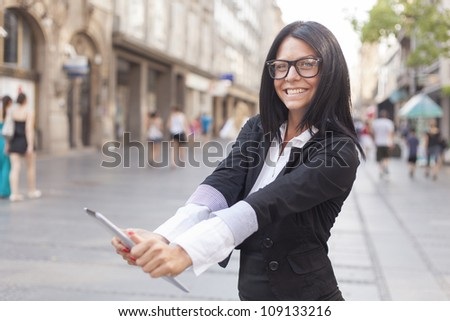 Smiling Business woman Using Tablet Computer on street, Business woman