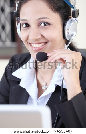 Smiling business woman wearing headset