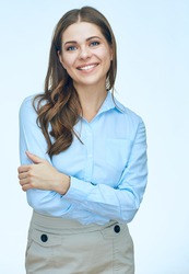 Smiling business woman with crossed arms standing against white background. Isolated.