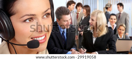Smiling  business woman with headset in the office.