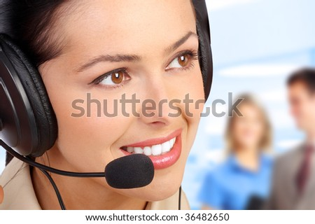 Smiling  business woman with headset in the office - stock photo