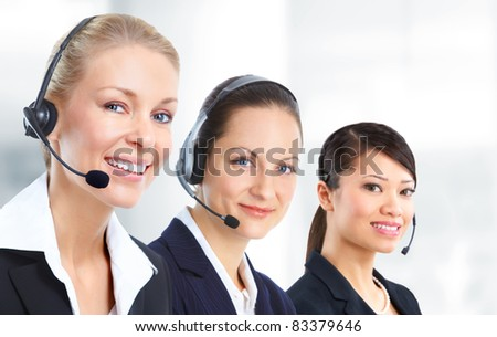 Smiling business woman with headsets. In the office.