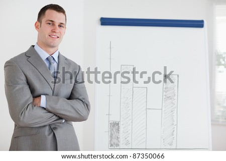 Smiling businessman confident about his diagram