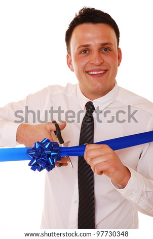 smiling businessman cuts a opening ribbon - stock photo