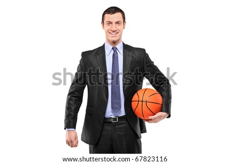 Smiling businessman holding a basketball isolated against white background