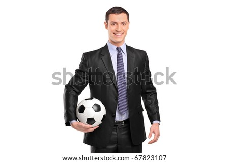 Smiling businessman holding a football isolated on white background