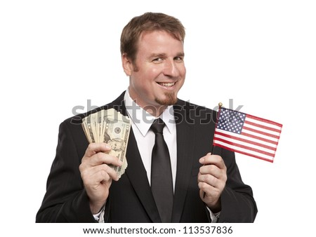Smiling businessman holds up a flag and money