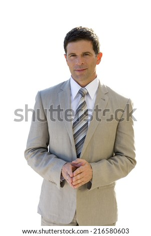 Smiling businessman in suit with hands clasped