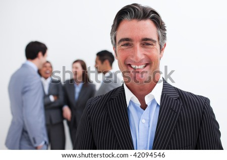 Smiling businessman leading her team agaisnt white background