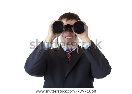 Smiling businessman looks through binoculars and espies business.Isolated on white background