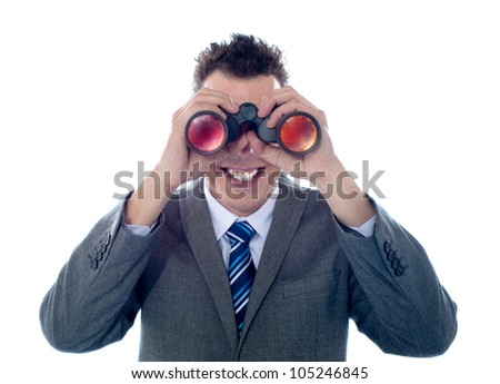 Smiling businessman looks through binoculars and seeks success. All on white background