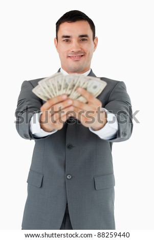 Smiling businessman presenting his bank notes against a white background