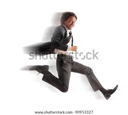 Smiling businessman running fast - stock photo