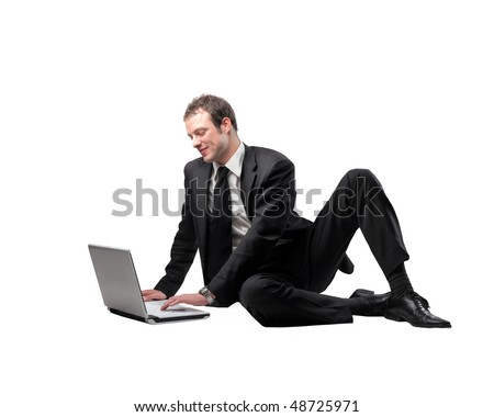 Smiling businessman sitting with a laptop in front of him