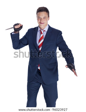 Smiling businessman with a knife getting ready to stab
