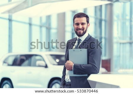 Smiling businessman with clipboard Stock photo ©