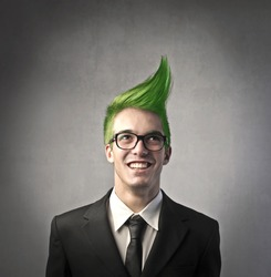 Smiling businessman with green upright hairstyle