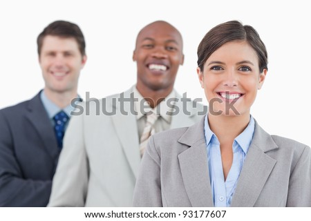 Smiling businessteam standing together against a white background
