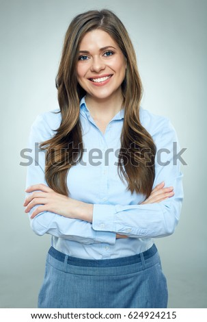 Smiling businesswoman blue shirt dressed standing on gray background. Studio isolated portrait. #624924215