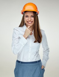 Smiling businesswoman builder isolated portrait on white background.