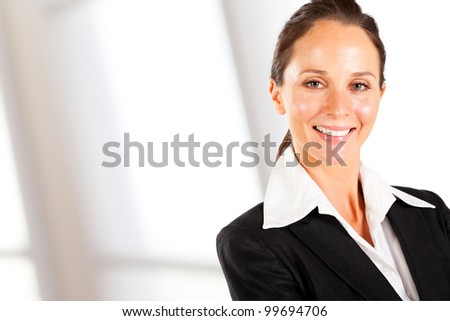 smiling businesswoman closeup portrait on white