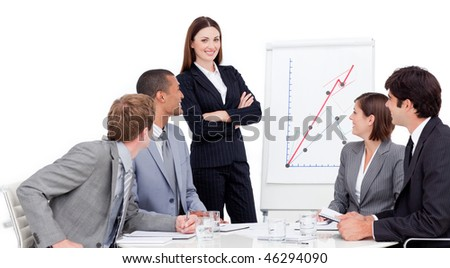 Smiling businesswoman giving a presentation to her team