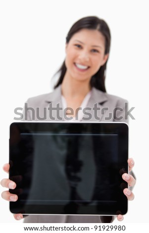 Smiling businesswoman presenting tablet screen against a white background