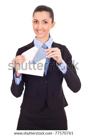 smiling businesswoman sending mail, looking at camera, isolated