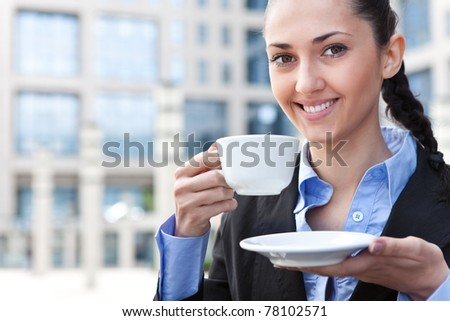 smiling businesswoman with cup of coffee, outdoor, close up